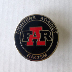 "Black and nickel enamel badge with ""Fighters Against Racism"" logo"